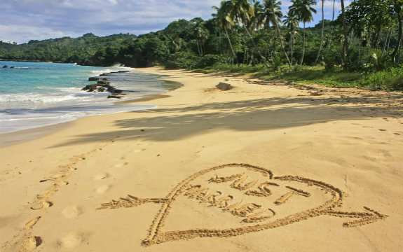 Just Married Written in Beach Sand on Tropical Island