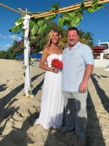 Kate and Jesse under tropical arch on St. Croix beach