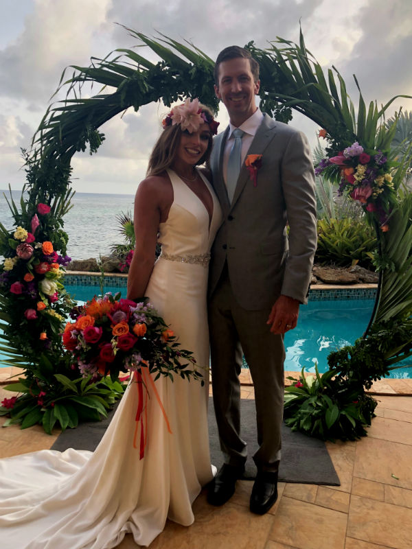 Bride and Groom under Palm Arch on Beach
